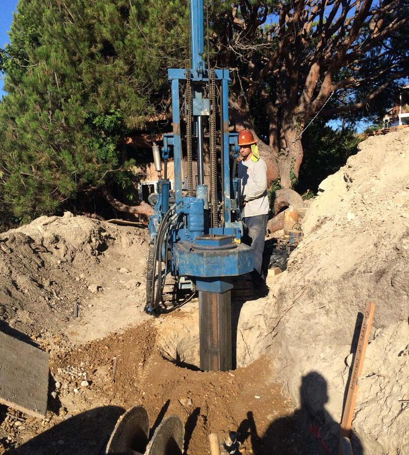 Boring the holes for the cast in place foundations. Pacificland Constructors