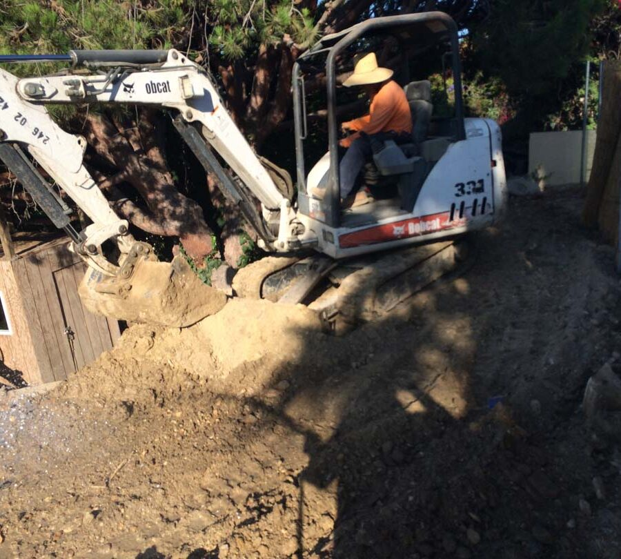 Preparing the area that will serve as the new retaining wall's foundation. Pacificland Constructors
