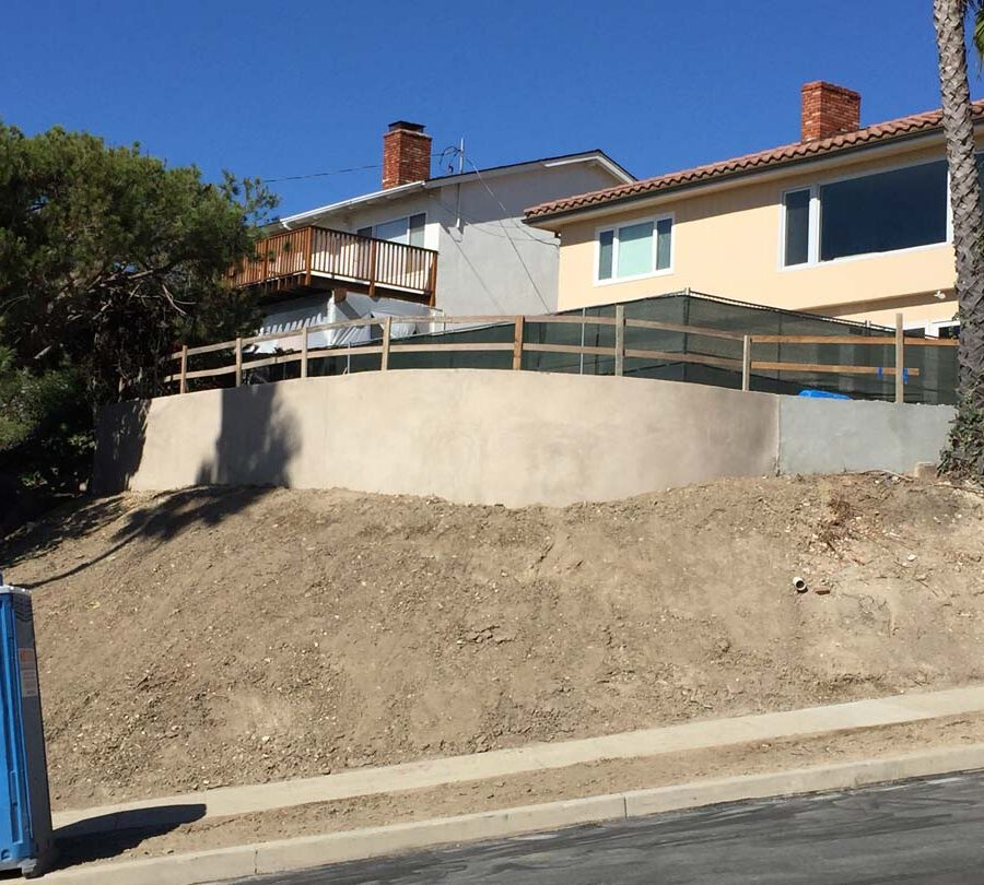 New retaining wall creating more flat area for a pool deck while simultaneously creating an open view for the owner. Pacificland Constructors