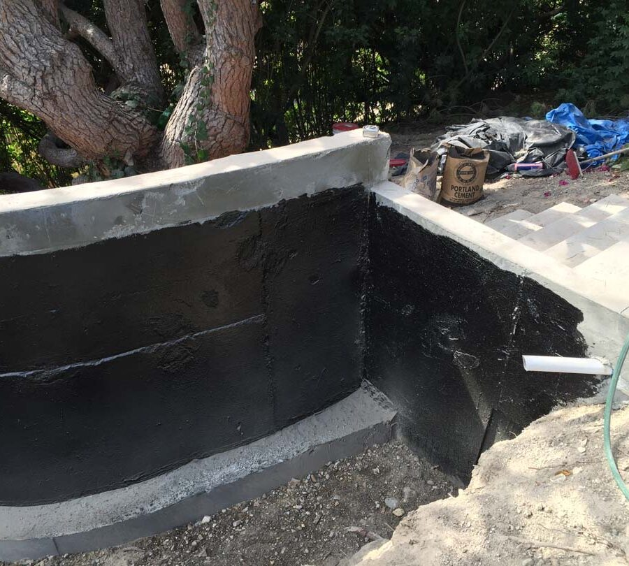 Construction of a new retaining wall application of waterproofing. Pacificland Constructors
