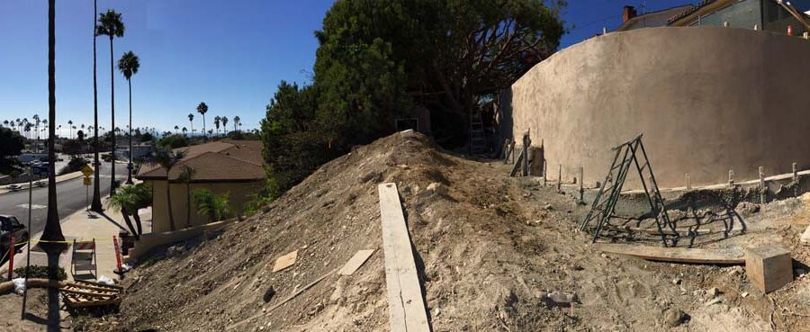 Construction of a new retaining wall application of colored stucco. Pacificland Constructors