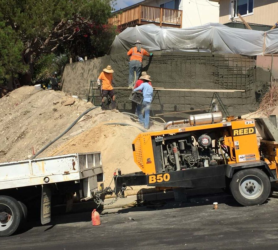 Construction of a new retaining wall shotcrete shooting. Pacificland Constructors