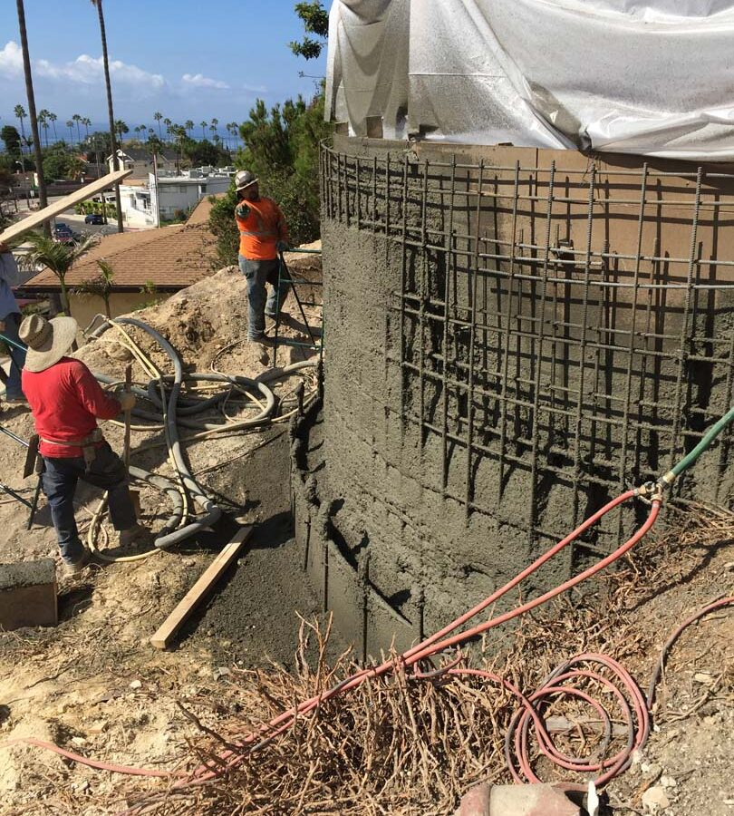 Construction of a new retaining wall shotcrete shooting and leveling. Pacificland Constructors
