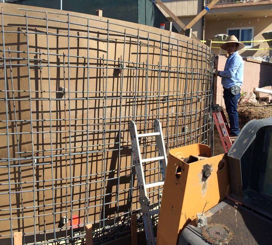 Martin, founder of Pacificland, tieing steel rebar reinforcement for a retaining wall. Retaining walls allow you to use more of your Brick work is a great option to raise the value of your home. Pacificland Constructors