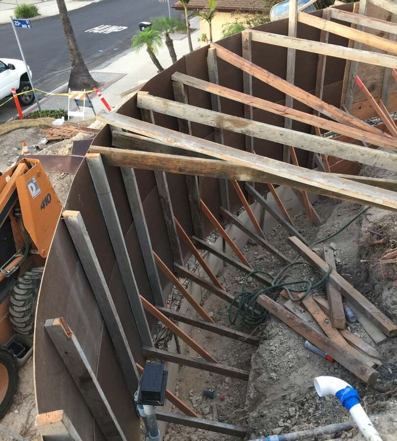 Construction Framework for a new retaining wall. Pacificland Constructors