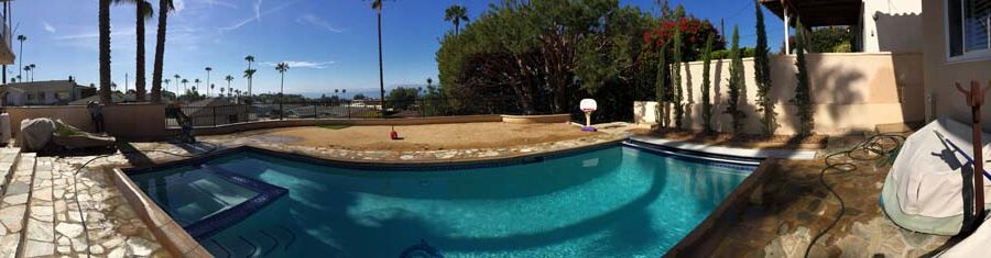 Panoramic view of the pool deck scenery over the retaining wall that was built by Pacificland Constructors.
