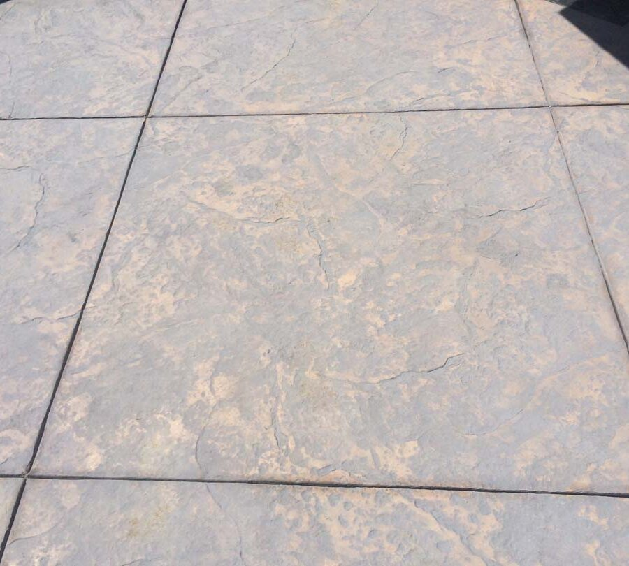 New stamped concrete with hand scorched square joints. Pacificland Constructors