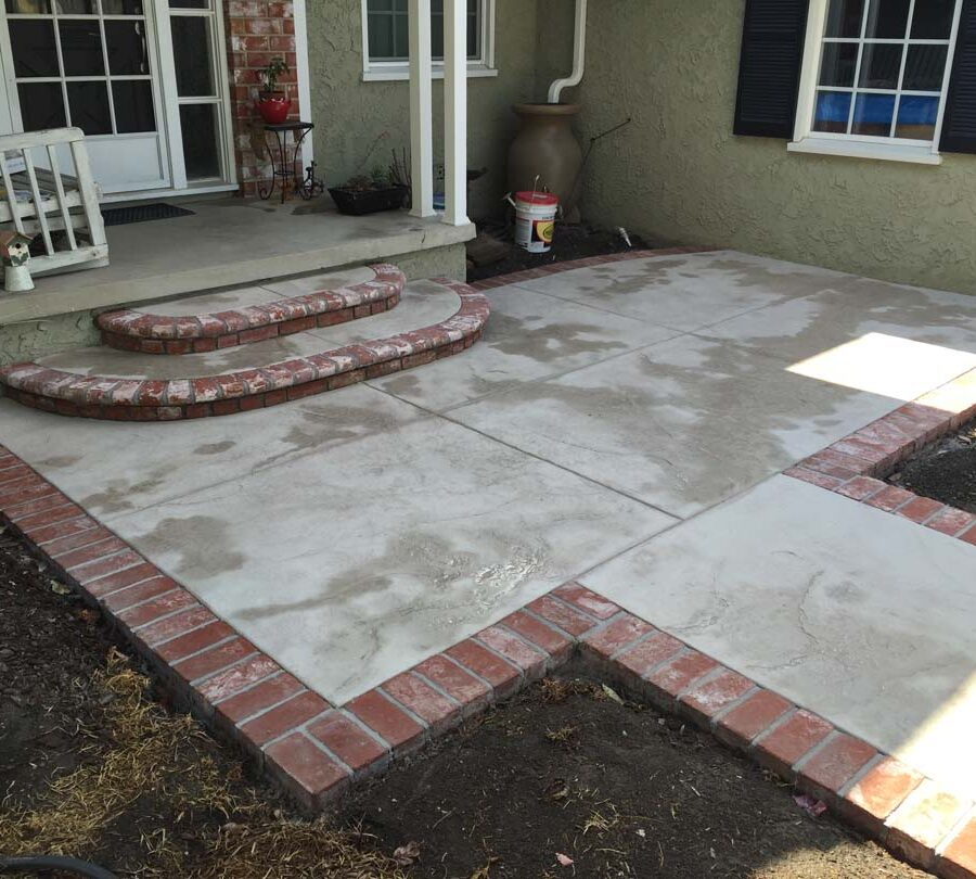 New backyard patio with manufactured white stained brick ribbons that creates a vintage look. Pacificland Constructors