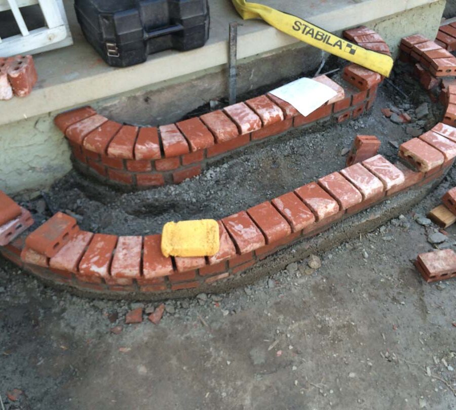 Construction of new brick steps with manufactured white stained brick that will create a vintage look. Pacificland Constructors