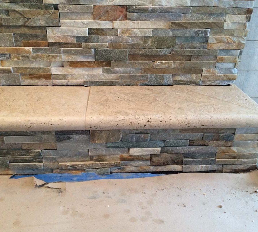 Using concrete precast with bull-nosed edge is a great choice for the outer hearth of a fireplace. Pacificland Constructors