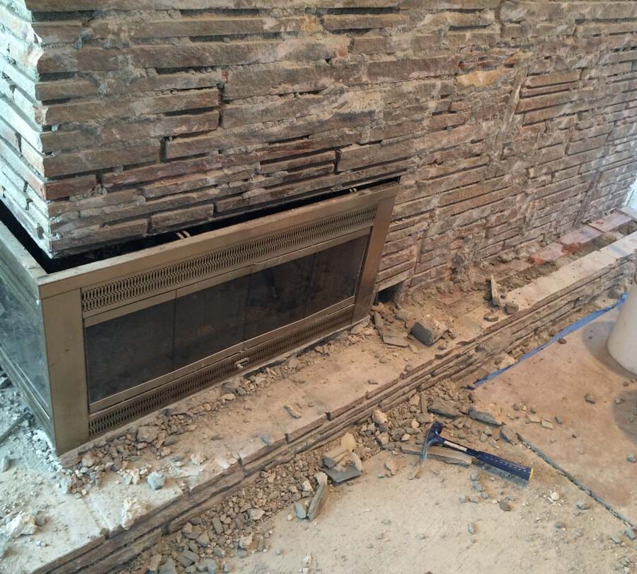Demolition of existing veneer to prepare and reinforce the chimney for new Stone Veneer. Pacificland Constructors