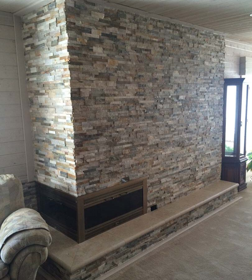 Stone covered chimney gives the home's living room a modern theme. Pacificland Constructors