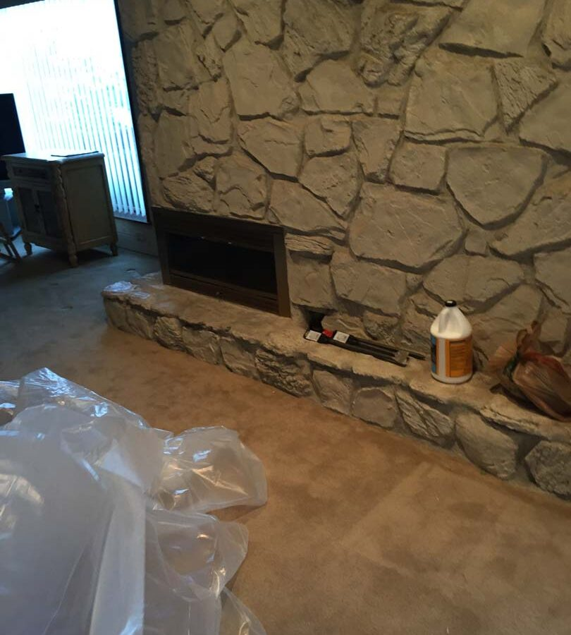 Outdated chimney veneer that was demolished and replaced with new modern style stone veneer. Pacificland Constructors