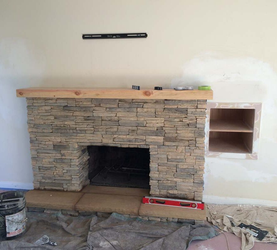 Construction for a stone veneer over the existing fireplace to create a vintage theme for the home. Pacificland Constructors
