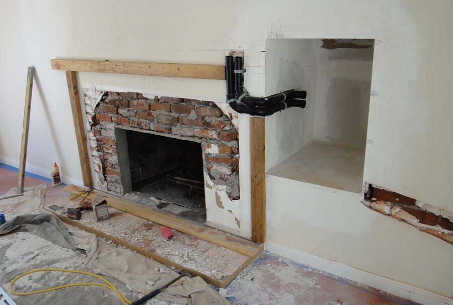 Frame layout construction for a stone veneer over the existing fireplace. Pacificland Constructors