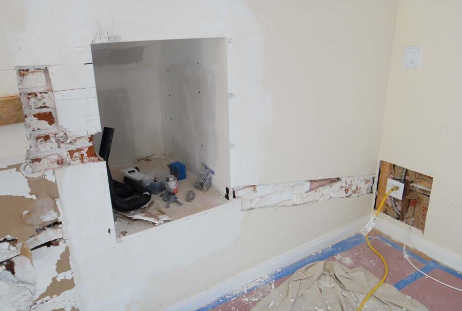 Demolition of the outdated fireplace for this home. Pacificland Constructors