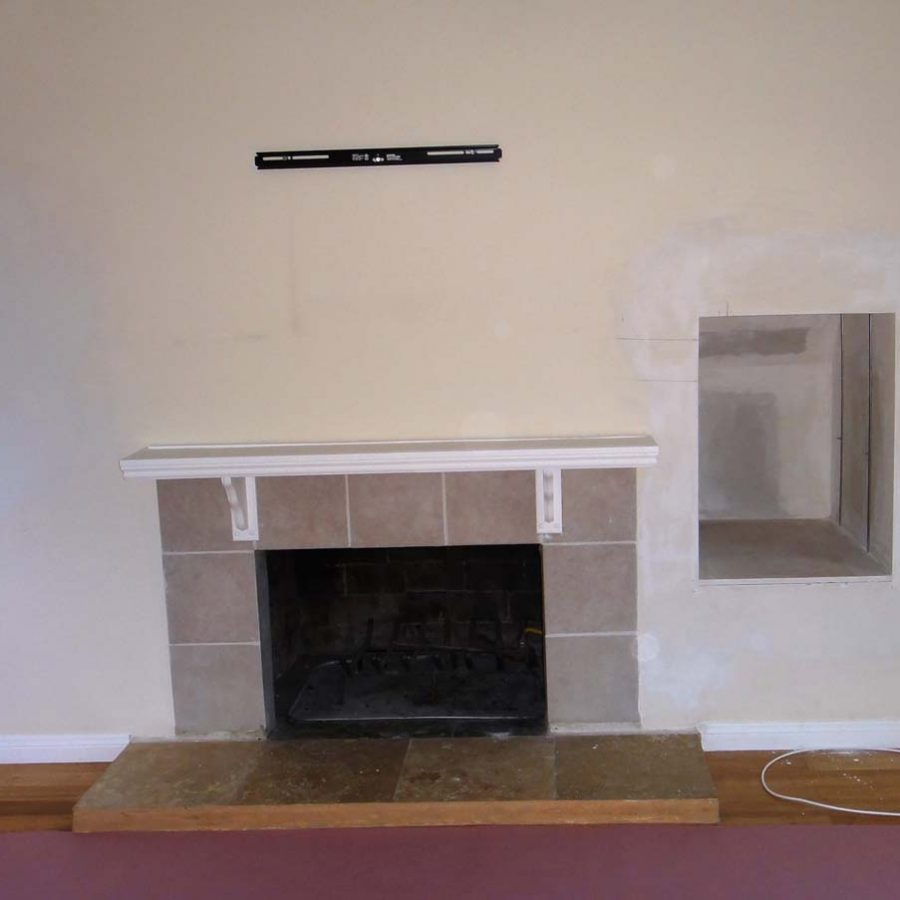 Outdated fireplace for this home that will be demolished. Pacificland Constructors
