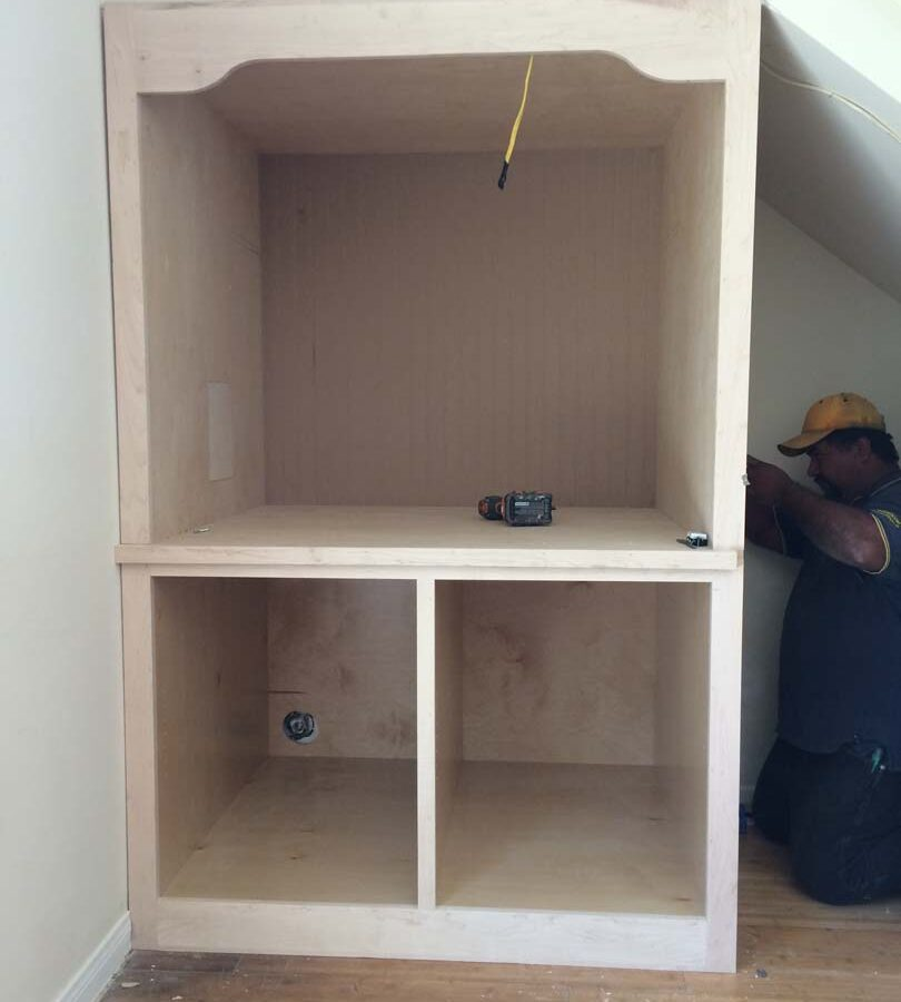 Construction of a new wooden drawer under the stairs of the home. Pacificland Constructors