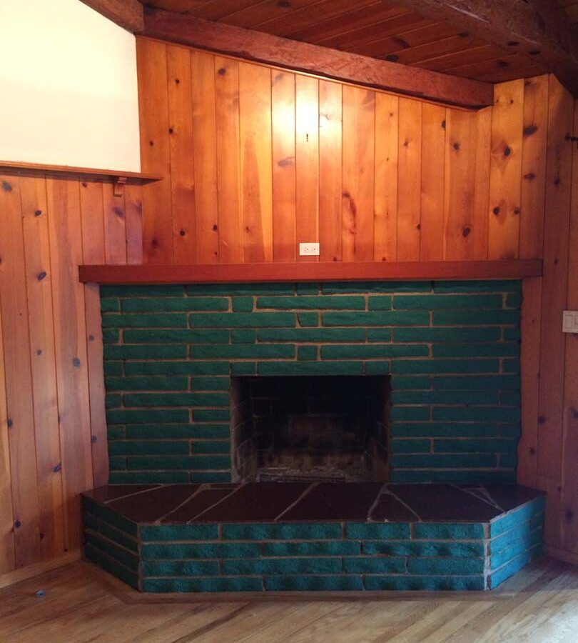 Old fireplace that was remodeled by Pacificland Constructors. It was sealed with a motar coating and reinforcement for new stone veneer.