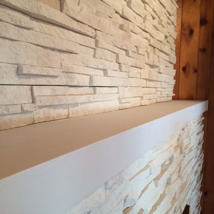 This white stone veneer is a great decoration for this living room area because it sets a relaxing and modern theme. Pacificland Constructors