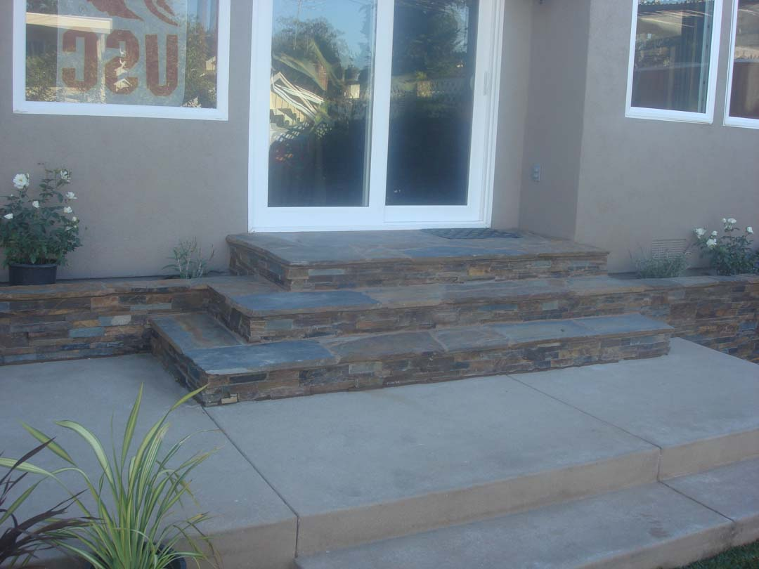 New Stone Veneer On The Face Of Concrete Steps Pacificland Constructors