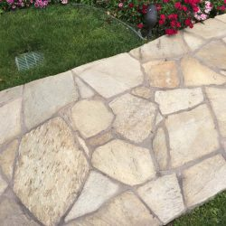 Flagstone walkway entrance that gives a natural feel. Pacificland Constructors