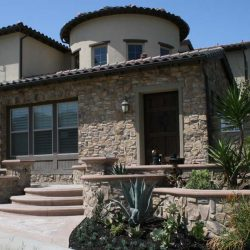 Existing stucco was removed and replaced with new stone veneer to give the home an architecturally vintage look. Pacificland Constructors