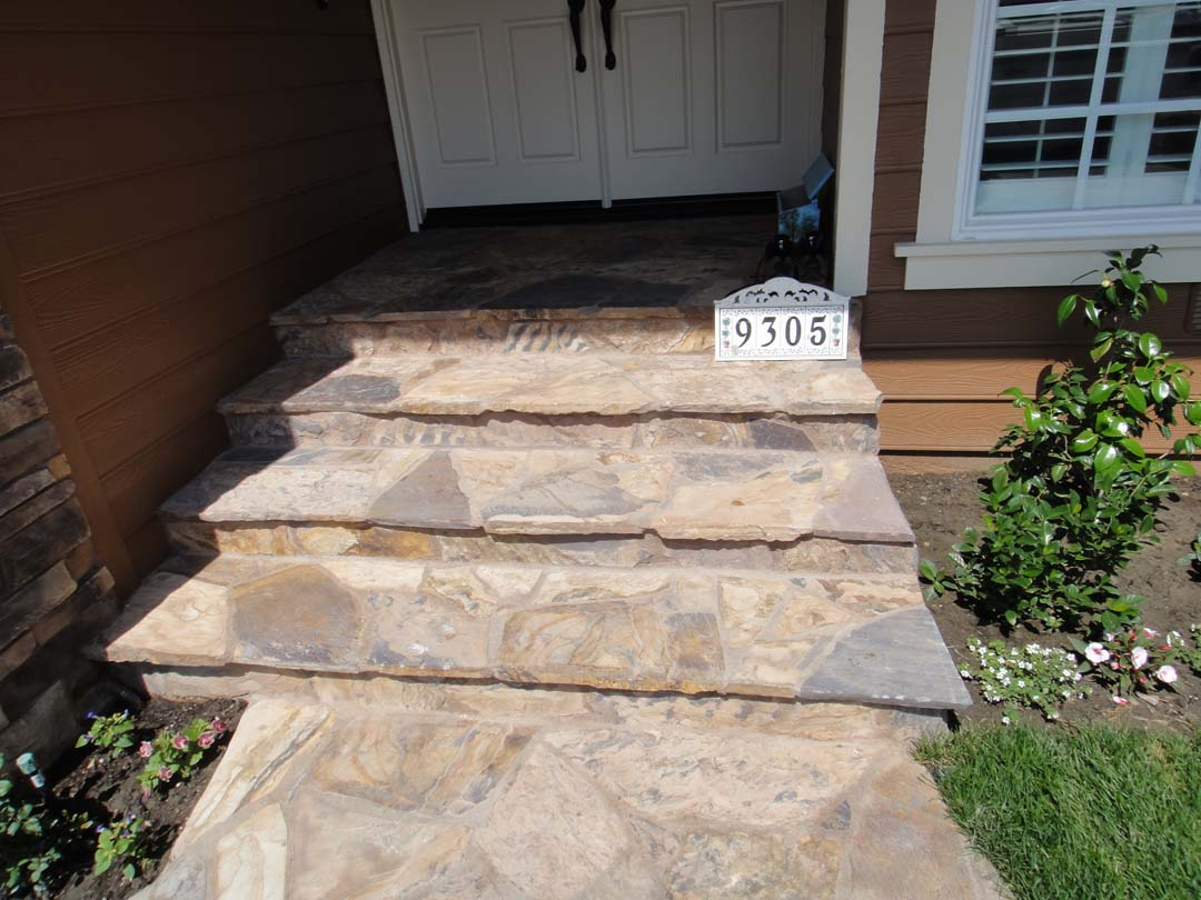 New Stone Flagstone Was Placed On The Front Yard Entrance Steps Of Home