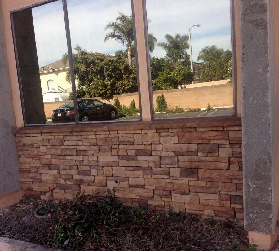 Stone veneer at the exterior of a commercial building. Pacificland Constructors