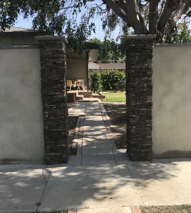 Front entrance to the yard. Finished Pilasters with stone veneer topped off with stepstone caps. Pacificland Constructors