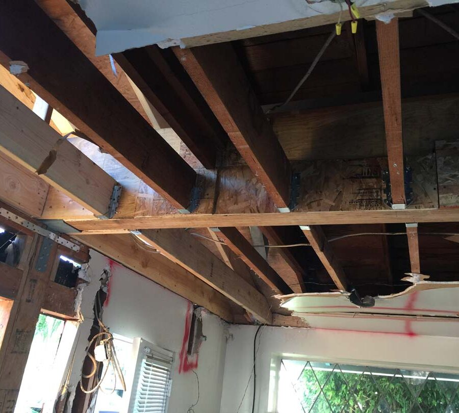 Removal of load bearing wall with a hidden beam slit inside the ceiling. Pacificland Constructors
