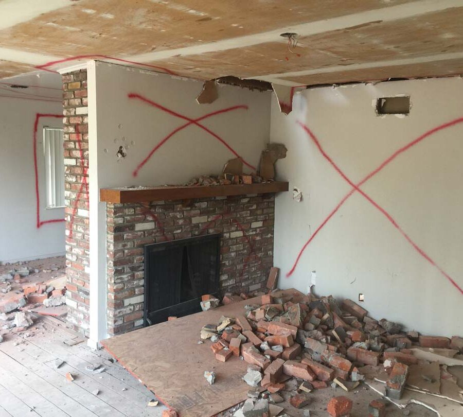 Demolition of the existing fireplace. Pacificland Constructors