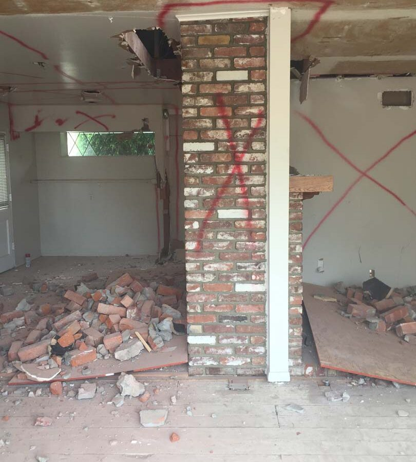Demolition of walls near the old fireplace. Pacificland Constructors