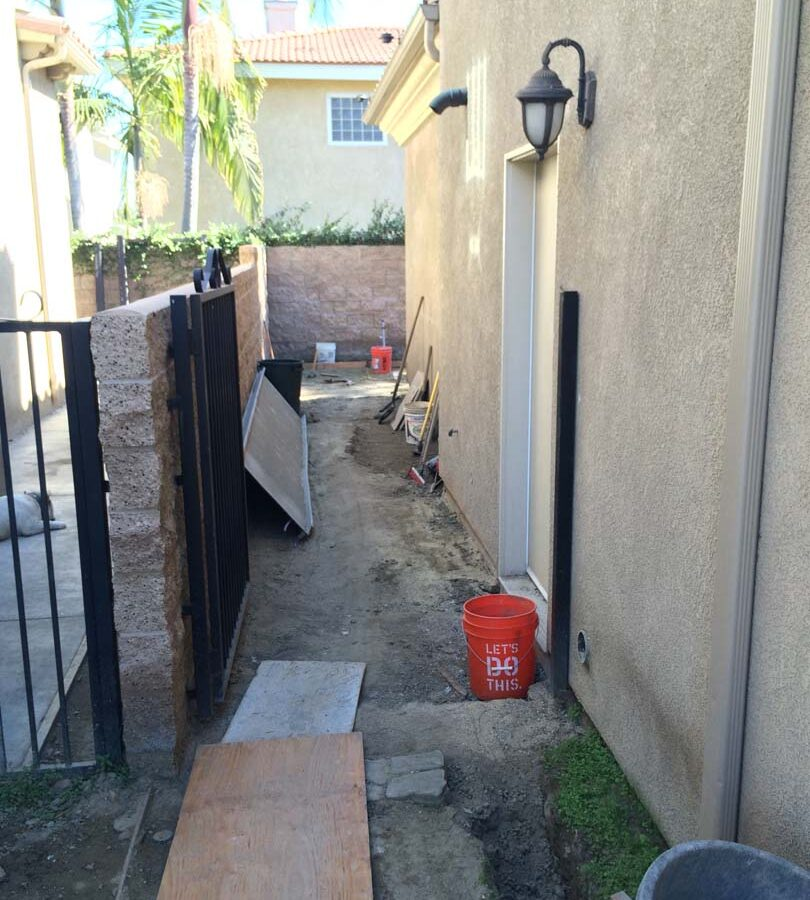 Construction of new colored stamped concrete for a backyard in Bellflower, CA. Pacificland Constructors
