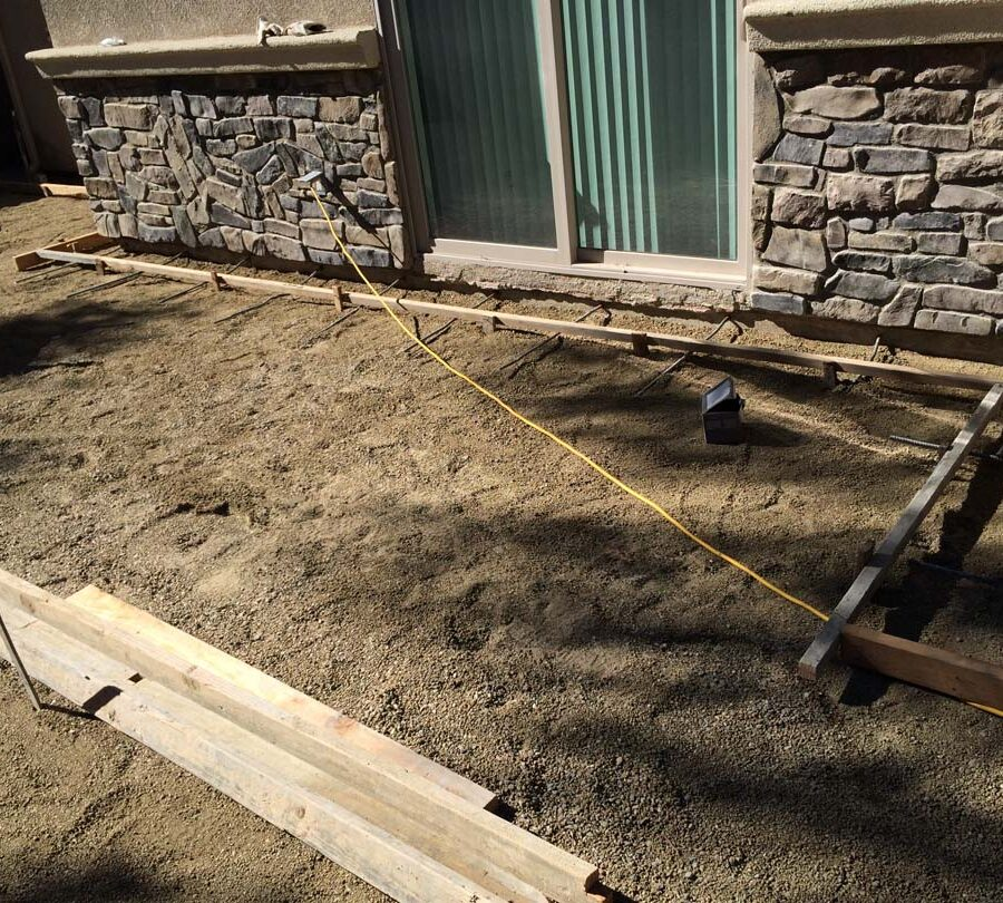 Grading and formwork construction for a new colored stamped concrete backyard in Bellflower, CA. We installed a drainage system throughout the backyard for optimal draining. Pacificland Constructors