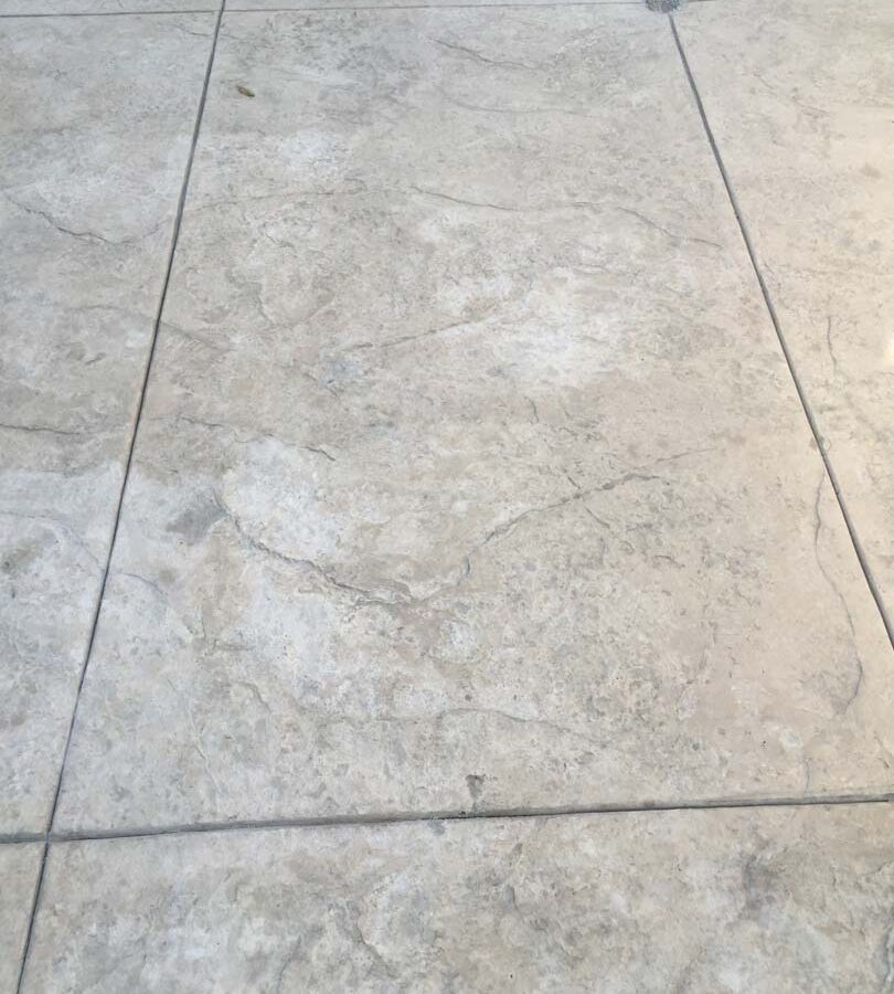 Colored stamped concrete with soff cut joints. Pacificland Constructors