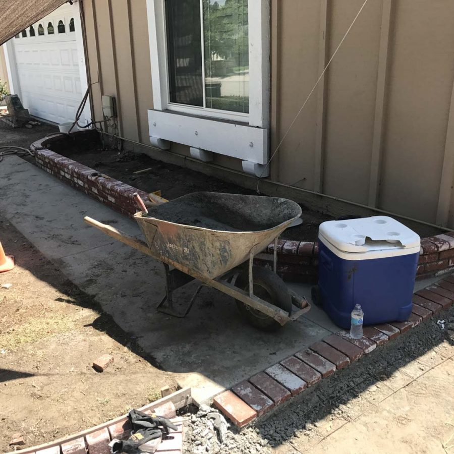 Construction of a new front yard concrete walkway with brick ribbons. Pacificland Constructors
