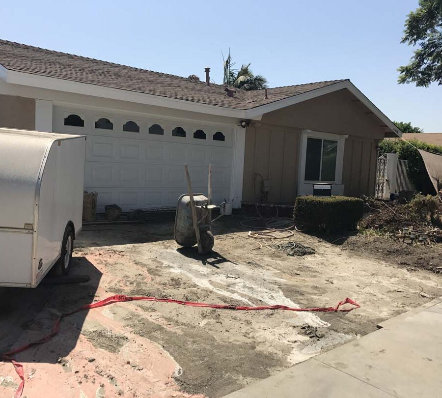 Construction of a new driveway. The existing driveway has been demolished an a new one will be prepared by grading, forming, and later pouring it. Pacificland Constructors