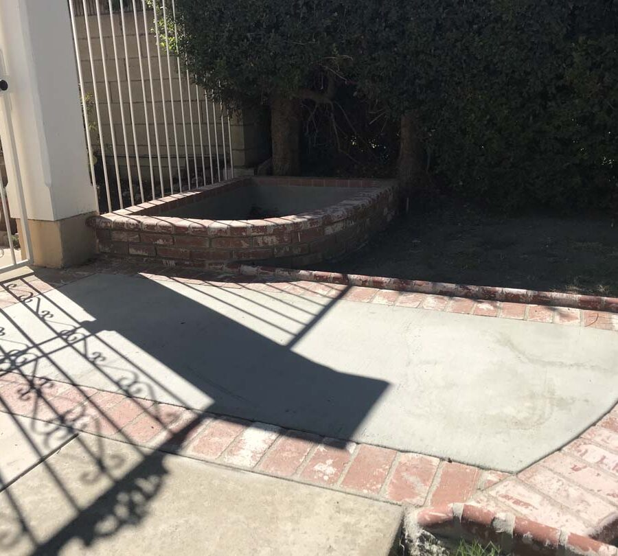 New front yard concrete walkway with brick ribbons and new brick planters. Pacificland Constructors