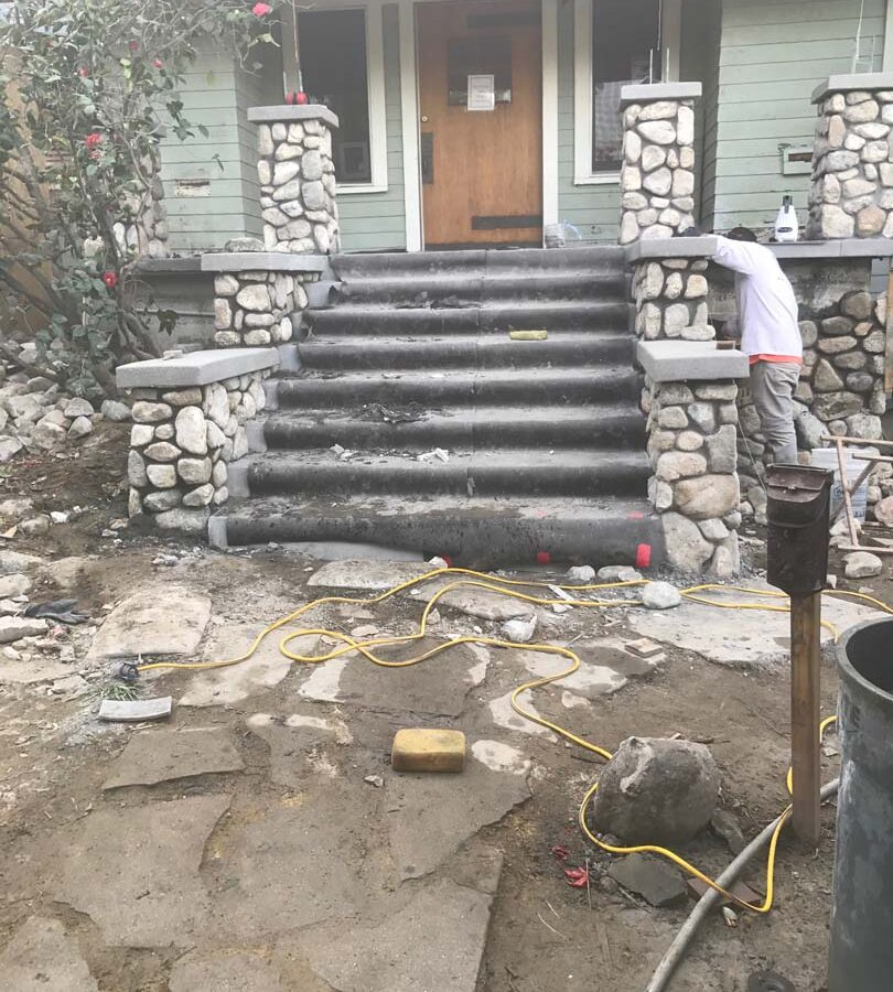 Construction of the restoration of the front porch. Pacificland Constructors