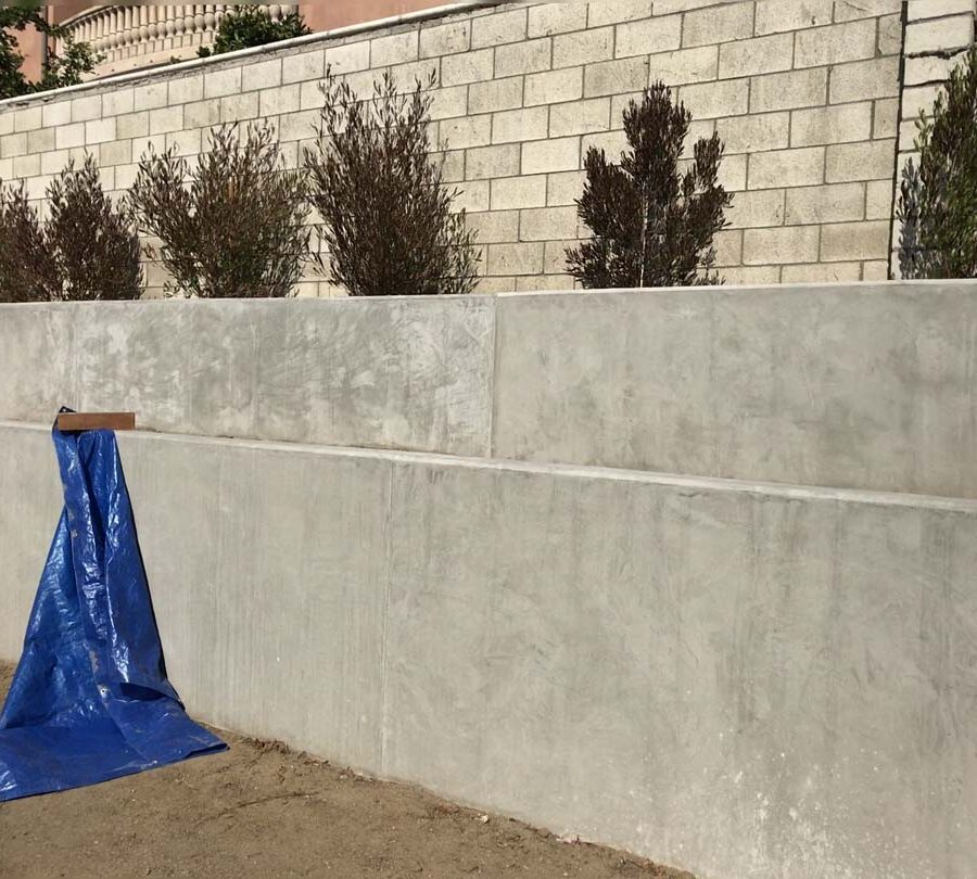New retaining wall for a backyard in Huntington Beach, CA. This retaining wall creates more flat area for the home because it holds up the differential earth elevation from the neighbor's home. Pacificland Constructors