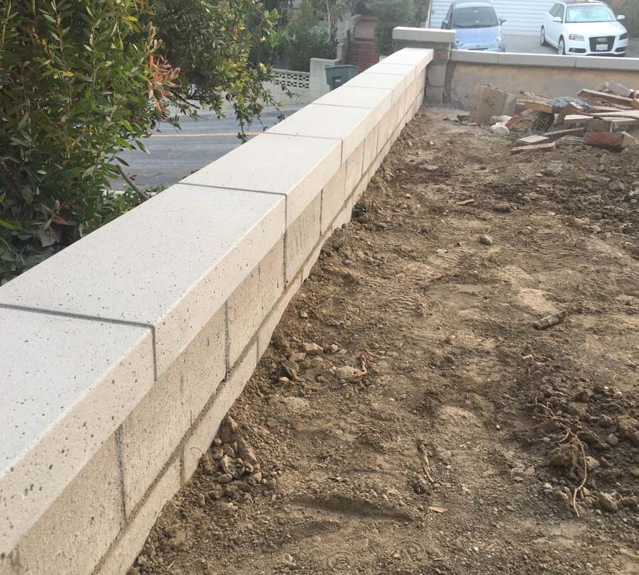 New precast wall cap for this home's existing retaining wall. Pacificland Constructors