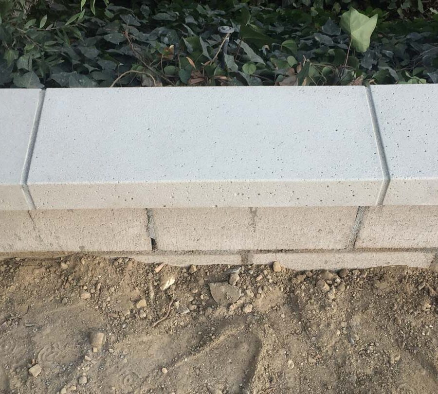 New precast wall cap for this home's existing planter wall. Pacificland Constructors