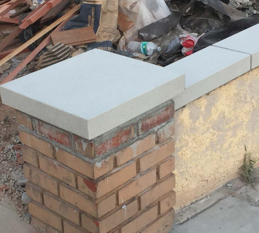 New precast wall cap for this home's existing planter wall and pilaster. Pacificland Constructors