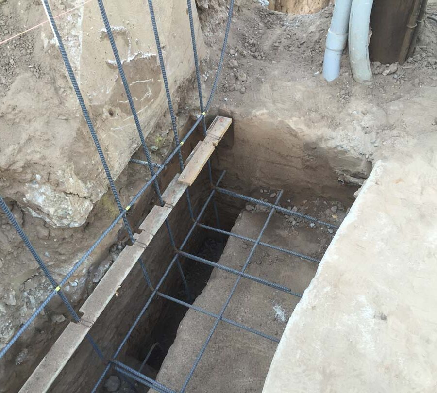 Steel reinforcement of strip footings for a retaining wall after excavating and cleaning them from loose dirt. Pacificland Constructors
