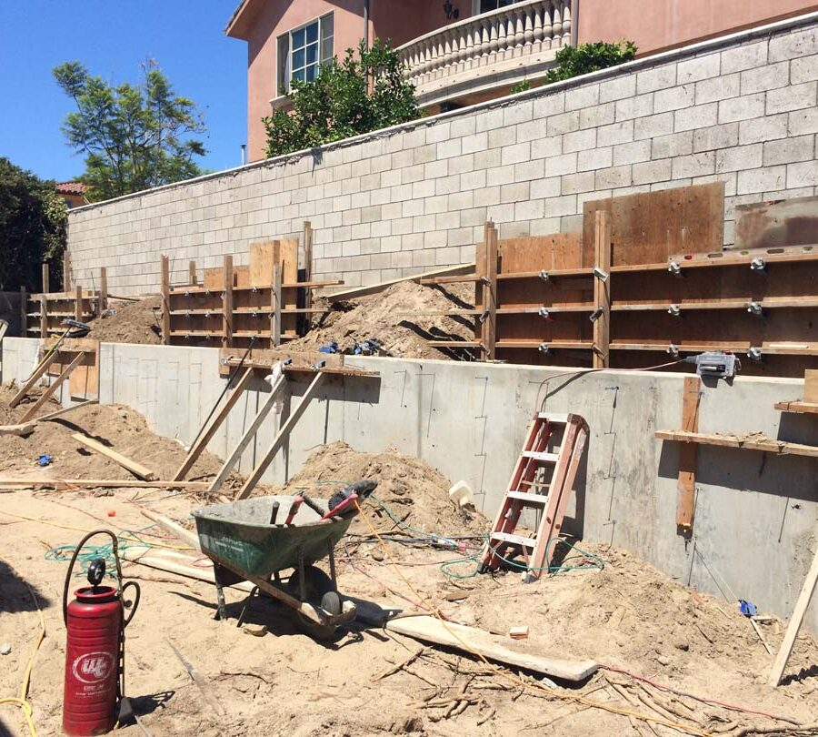 Formwork carpentry and reinforcement for a new concrete retaining wall for a backyard in Huntington Beach, CA.