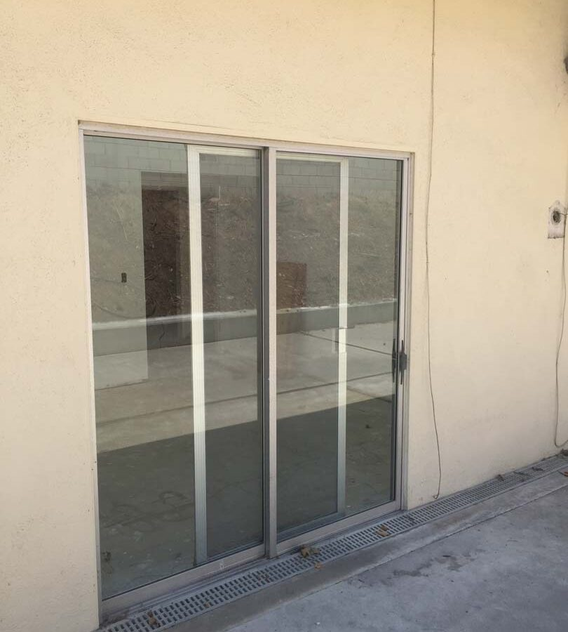 Old existing door that will be demolished and replaced with a new glass door and glass curtain walls. Pacificland Constructors