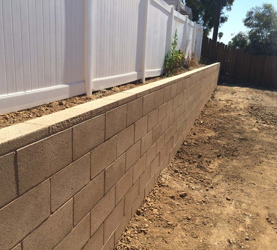 New tan precision block retaining wall. Pacificland Constructors
