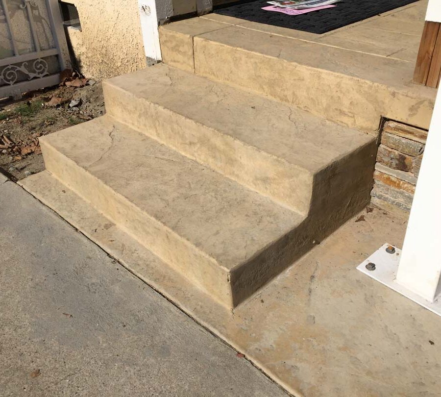 Colored stamped concrete with handmade joints. The steps have the stamped texture. Pacificland Constructors