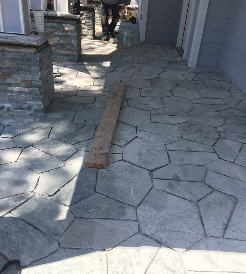 Construction of beautiful flagstone work. Each piece was hand cut and fixed in place; it will last a lifetime. Pacificland Constructors